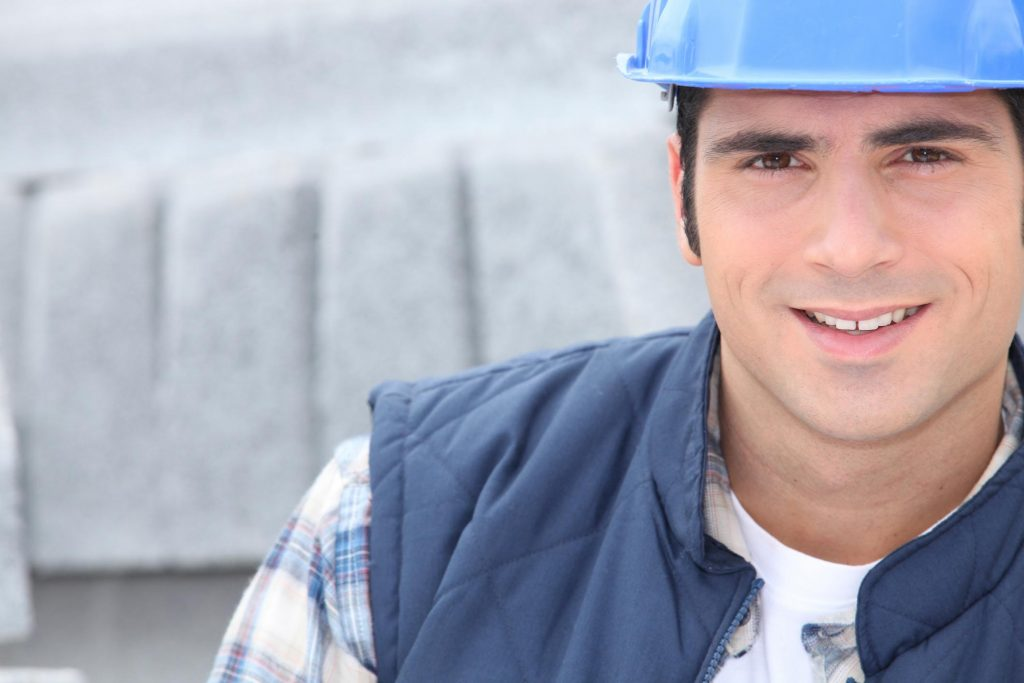 masonry and concrete worker smiling