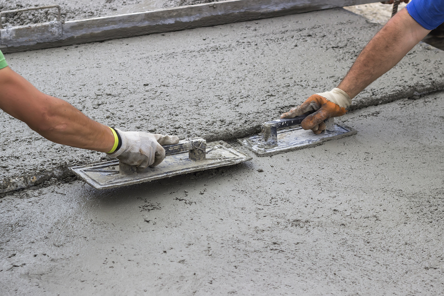 masonry and concrete worker working on driveway