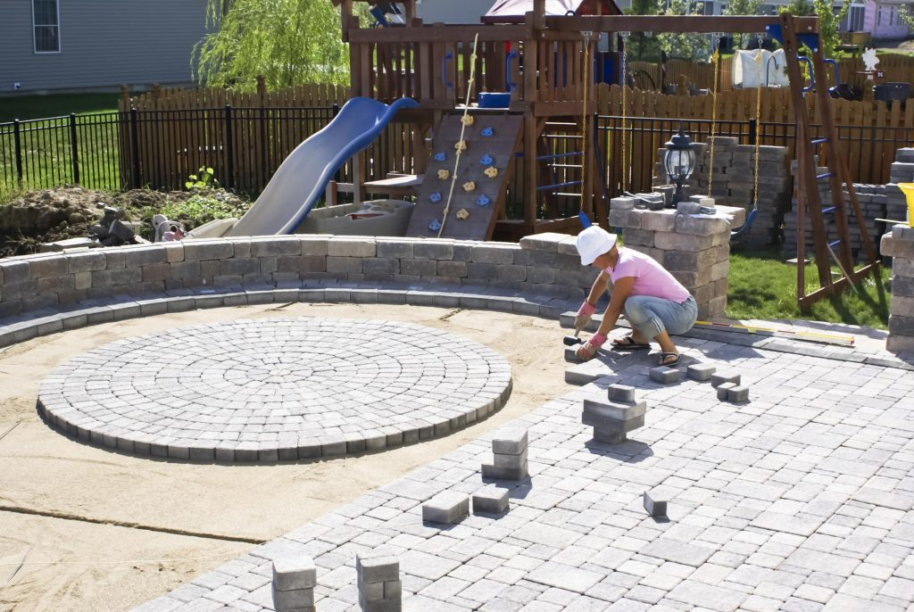 masonry and concrete worker working on patio